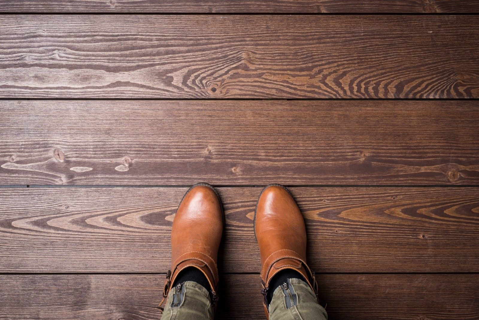 Woman in winter shoes standing on wooden floor | Elite Flooring and Interiors Inc