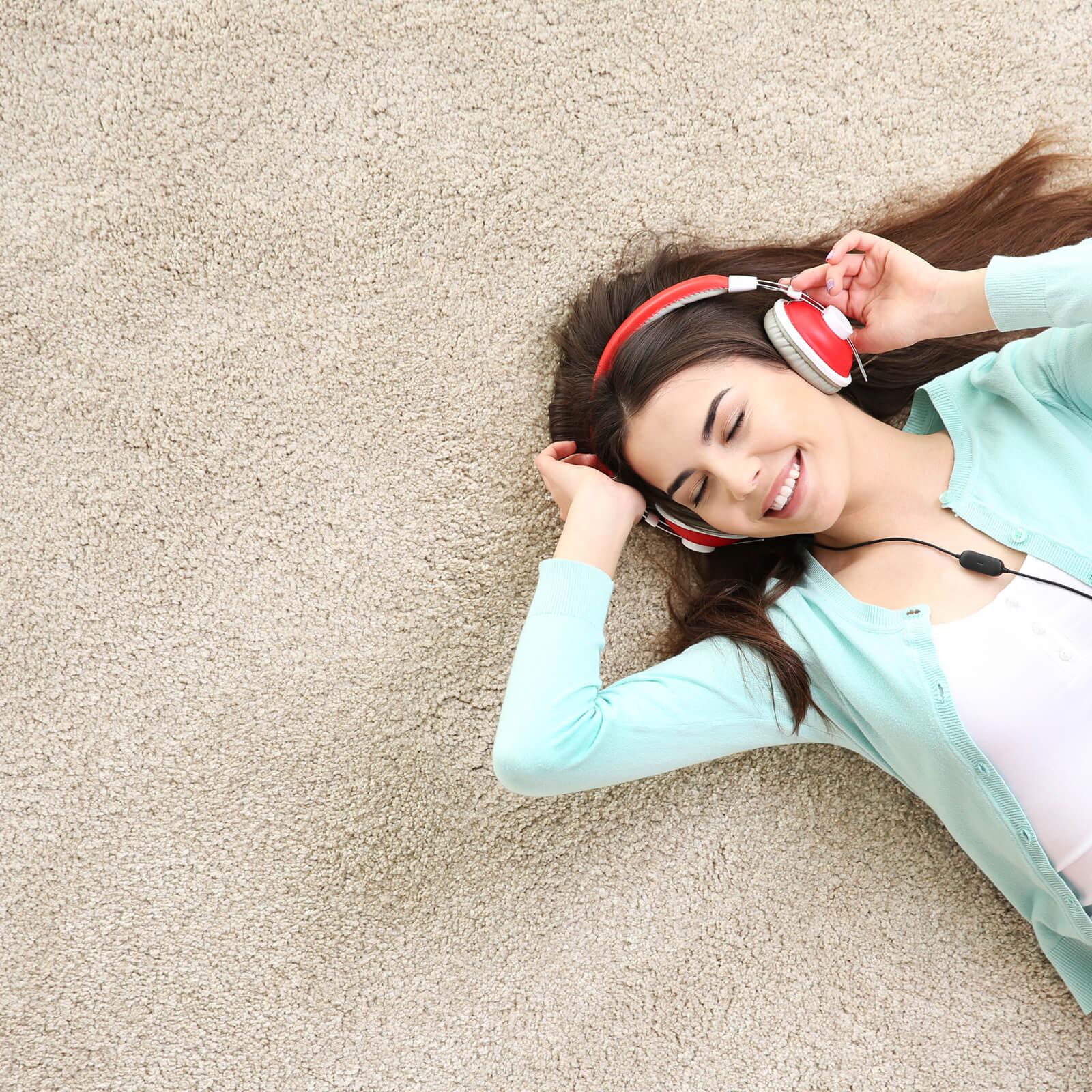 Girl relaxing on carpet | Elite Flooring and Interiors Inc