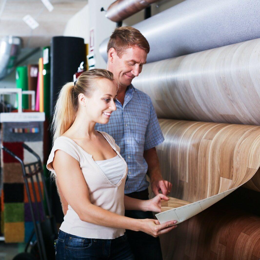Couple choosing linoleum in store | Elite Flooring and Interiors Inc